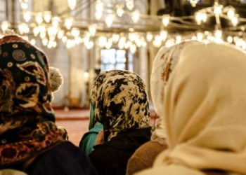 Women praying inside a mosque