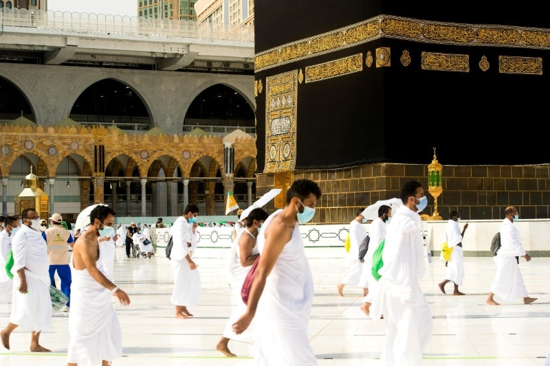 FILE PHOTO: Muslim pilgrims wearing face masks and keeping social distance perform Tawaf around Kaaba during the annual Haj pilgrimage amid the coronavirus disease (COVID-19) pandemic, in the holy city of Mecca, Saudi Arabia July 31, 2020. Saudi Press Agency/Handout via REUTERS