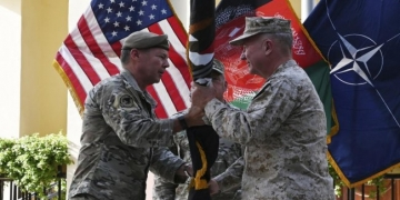 The head of US Central Command and the top US commander of coalition forces in Afghanistan take part in an official handover ceremony in Kabul on 12 July 2021 (AFP)