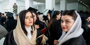 Women graduates celebrate after more than 100 Afghan students from the American University of Afghanistan (AUAF) receive their diplomas at a graduation ceremony on campus on 21 May 2019